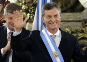 Argentina's President Mauricio Macri waves after receiving the presidential sash at the government house in Buenos Aires, Argentina, Thursday, Dec. 10, 2015. Macri, the former mayor of Buenos Aires who hails from one of Argentina's richest families, took the oath of office in Congress in front of legislators, several Latin American heads of state and other dignitaries. (AP Photo/Victor R. Caivano)